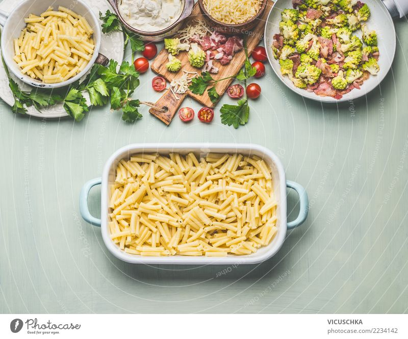 Prepare pasta gratin with broccoli and ham Food Meat Sausage Vegetable Nutrition Lunch Dinner Organic produce Crockery Style Design Living or residing Table