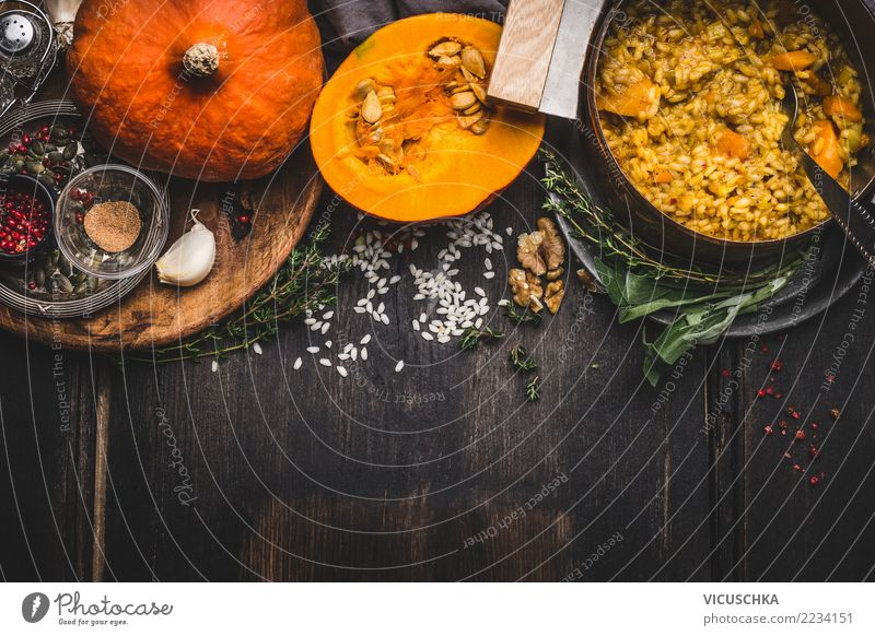 Vegetarian pumpkin risotto Food Nutrition Lunch Dinner Banquet Organic produce Diet Italian Food Pot Spoon Healthy Eating Living or residing Table Kitchen