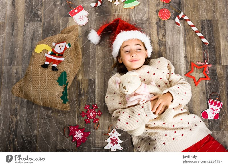 Little girl wearing santa hat sleeping on wooden floor Happy Beautiful Decoration Christmas & Advent Child Girl Woman Adults Infancy 1 Human being 3 - 8 years