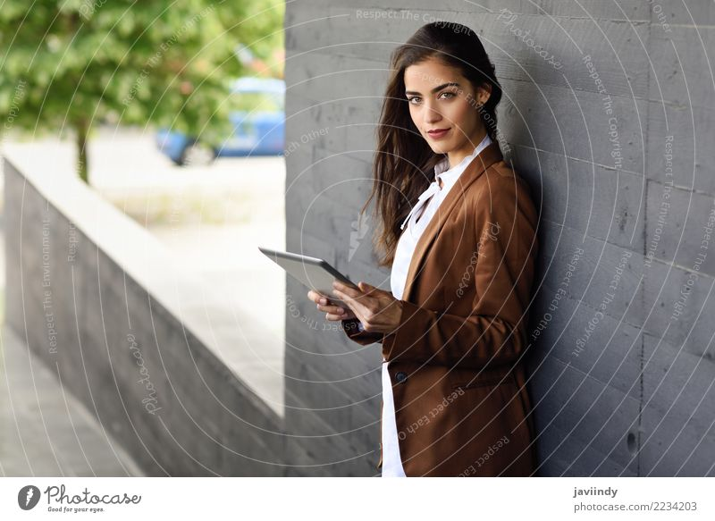 Woman with tablet computer outside of an office building. Beautiful Hair and hairstyles Workplace Office Business Career Human being Feminine Young woman