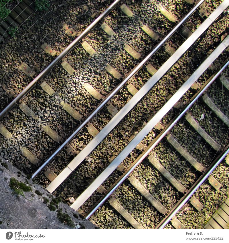 Step back, please! Bridge Railroad tracks Sand Concrete Metal Diagonal Line Colour photo Exterior shot Shadow Bird's-eye view Deserted Cable Parallel Day