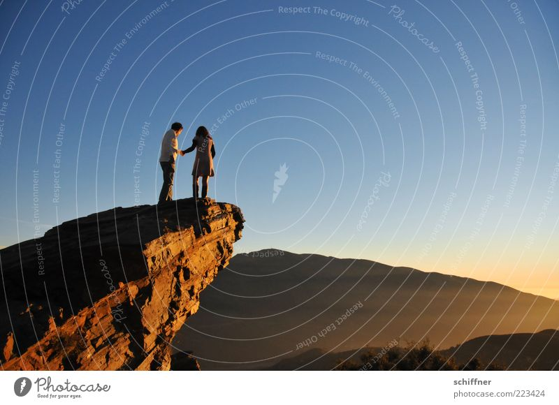 Love, profound Human being Couple Partner 2 Nature Elements Sky Cloudless sky Beautiful weather Rock Mountain Discover Stand Bravery Passion Trust Protection