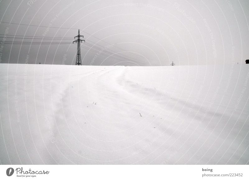 Winter Snow Tracks Electricity pylon High voltage power line Snow layer