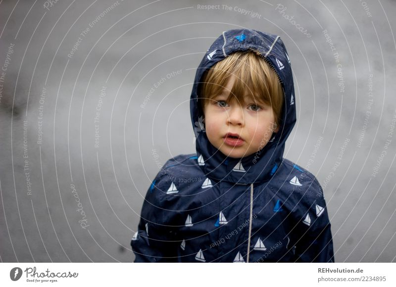 terrible weather Human being Child Toddler Boy (child) Infancy Head Face 1 3 - 8 years Environment Nature Autumn Weather Bad weather Rain Town Street Stand