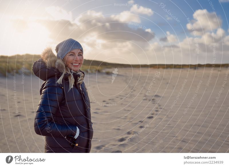 Trendy woman standing on a beach at sunset Lifestyle Happy Face Vacation & Travel Adventure Freedom Sun Beach Ocean Woman Adults 1 Human being 30 - 45 years