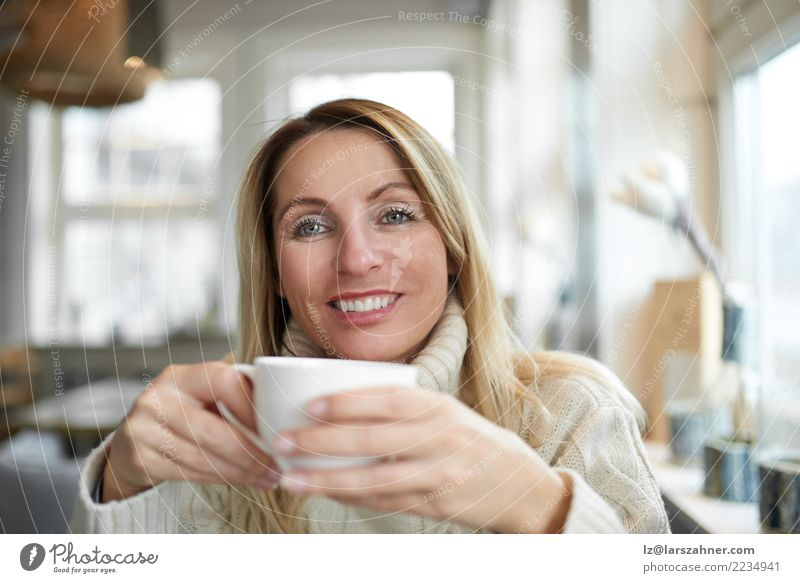 Beautiful woman relaxing at home with coffee Beverage Drinking Coffee Tea Happy Face Calm House (Residential Structure) Living room Woman Adults 1 Human being