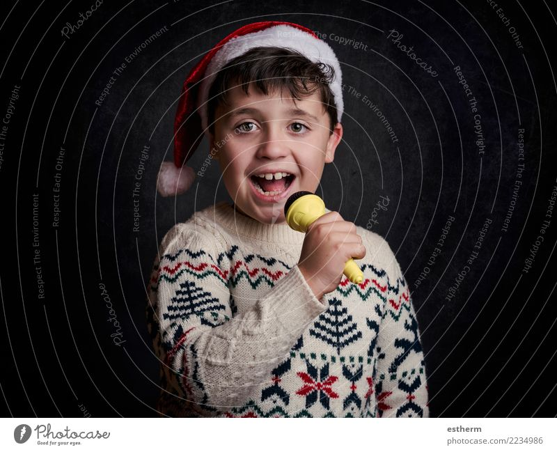 child singing Christmas carol at Christmas Child Human being Christmas & Advent Joy Lifestyle Funny Emotions Laughter Feasts & Celebrations Party Masculine