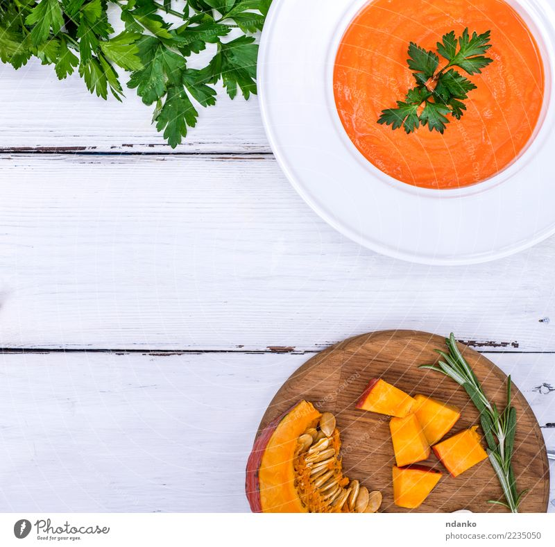 pumpkin soup in a white plate Vegetable Soup Stew Herbs and spices Nutrition Eating Lunch Dinner Vegetarian diet Diet Plate Table Kitchen Hallowe'en Wood Fresh