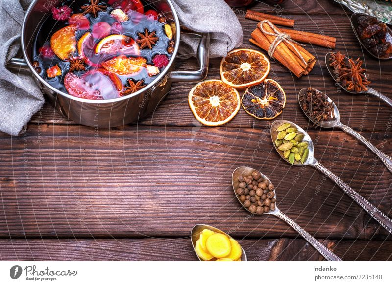 mulled wine in a saucepan and iron spoons Christmas & Advent Red Winter Wood Feasts & Celebrations Above Table Herbs and spices Beverage Hot Apple Tradition