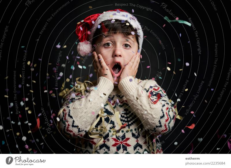 surprised child in New Year's Eve on black background Lifestyle Joy Party Event Feasts & Celebrations Christmas & Advent Human being Masculine Child Toddler