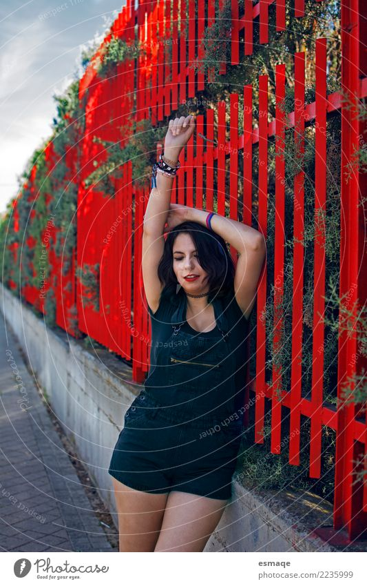 Young woman in street red Lifestyle Joy Beautiful Human being Feminine Youth (Young adults) 13 - 18 years 18 - 30 years Adults Village Wall (barrier)