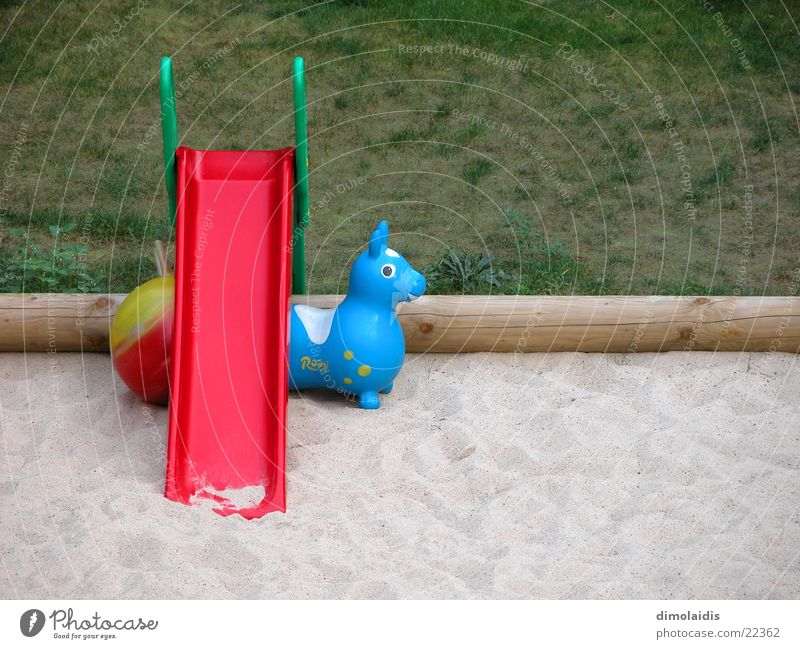 melancholic still life with slide Slide Rubber toy animal Sandpit Grass Tree trunk Leisure and hobbies Ball