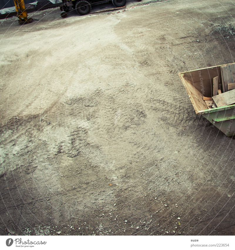 Environment Gray Sand Earth Arrangement Elements Floor covering Ground Construction site Tire Container Partially visible Gravel Real estate Trash container