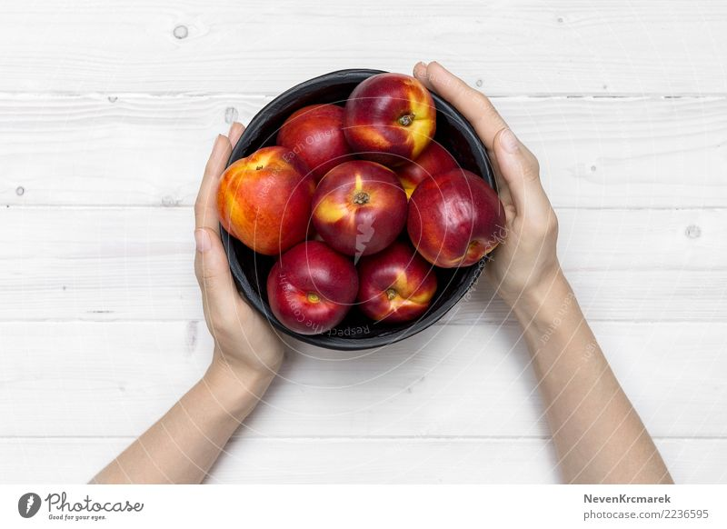 Female hands holding a bowl of nectarine Food Fruit Nectarine Nutrition Eating Breakfast Lunch Bowl Pot Cup Mug Nature Summer Diet Feeding Hand Mock-up Tabletop