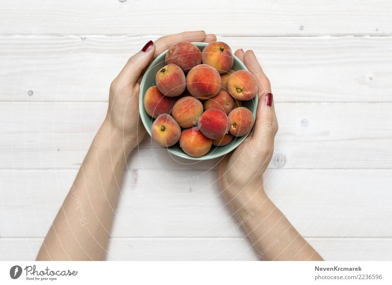 Female hands holding a bowl of peaches Healthy Eating Hand Food photograph Fruit Nutrition Fresh Organic produce Breakfast Bowl Cup Dinner Diet Food table