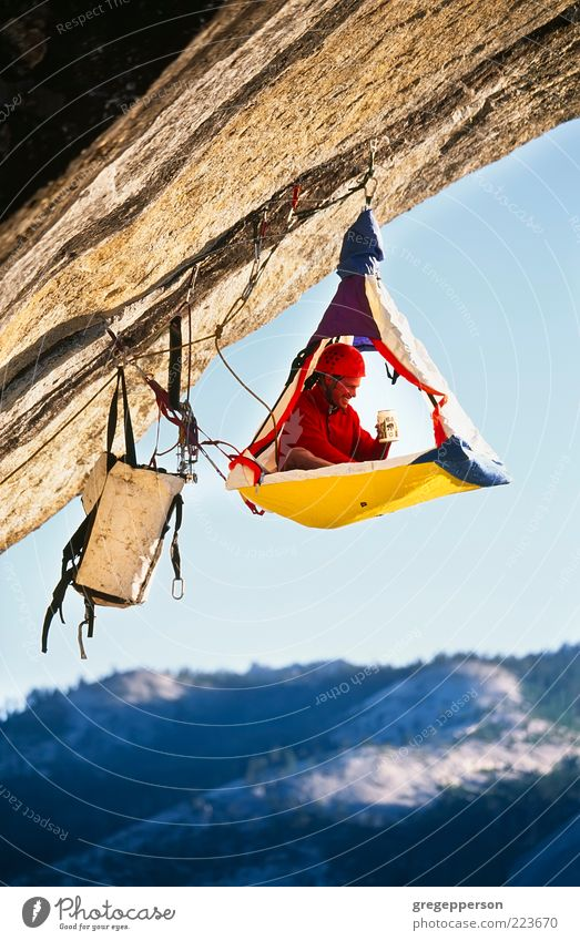 Rock climber bivouaced in a portaledge. Human being Man Loneliness Adults Life Sports Freedom Mountain Tall Adventure Rope Dangerous Safety Protection Climbing