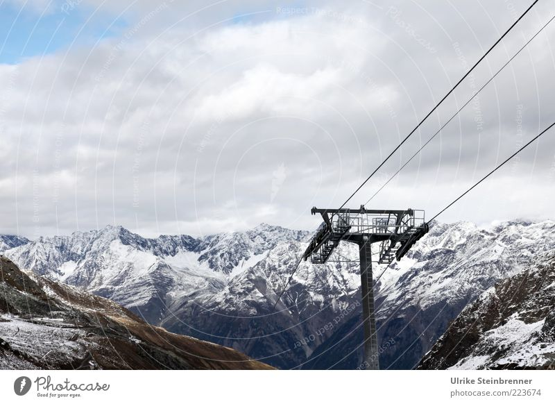 Clouds Winter Far-off places Cold Mountain Rock Alps Steel cable Snowcapped peak Column Upward Austria Passenger traffic Glacier Slope Holiday season
