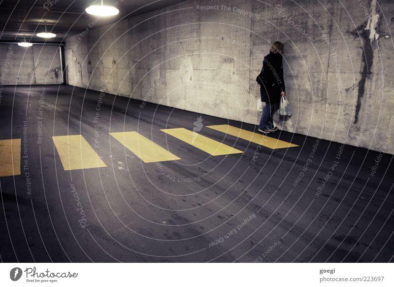 cul-de-sac Human being Woman Adults 1 Parking garage Wall (barrier) Wall (building) Pedestrian Jeans Coat Sneakers Blonde Long-haired Skylight Ceiling light