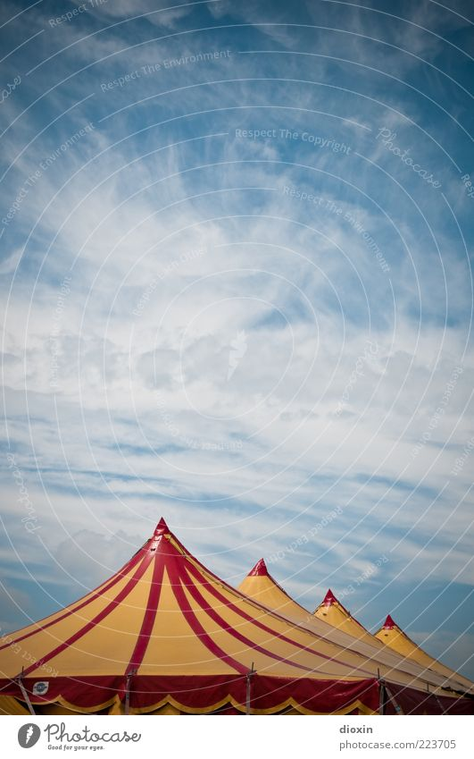 Circus air (FR 6/10) Event Sky Clouds Beautiful weather Point Blue Yellow Red White Leisure and hobbies Tent Circus tent Colour photo Exterior shot Deserted