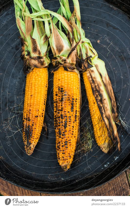 Roasted corn on the grill Summer Yellow Nutrition Gold Fresh Delicious Vegetable Hot Meal Vegetarian diet Organic BBQ Butter Corn cob