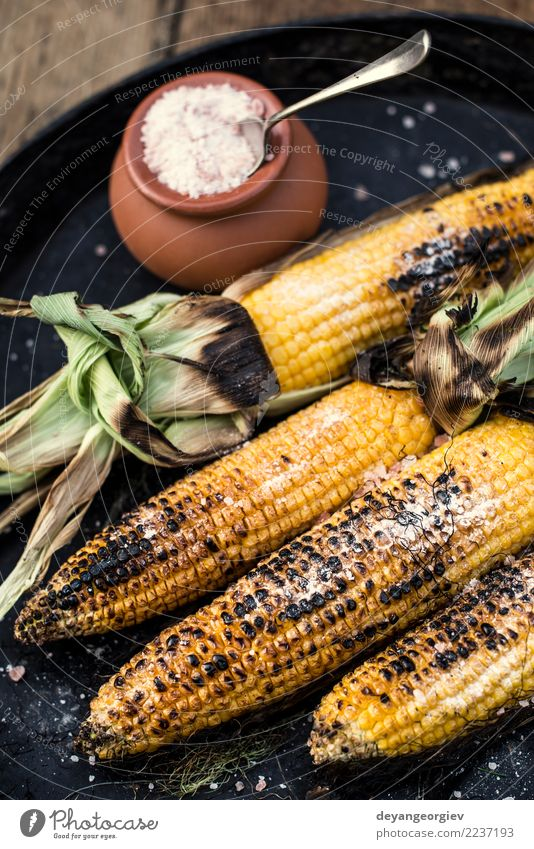 Roasted corn salted. Vegetable Nutrition Vegetarian diet Summer Wood Hot Yellow White BBQ roasted food cob background Snack Vantage point Organic Rustic Top