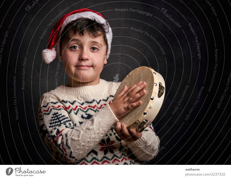child singing Christmas carol at Christmas Child Human being Christmas & Advent Joy Lifestyle Emotions Happy Feasts & Celebrations Party Masculine Infancy