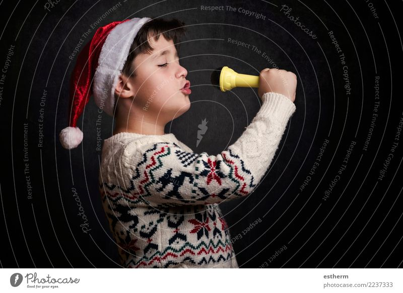child singing Christmas carol at Christmas Child Human being Christmas & Advent Joy Lifestyle Funny Emotions Happy Feasts & Celebrations Party Masculine Infancy
