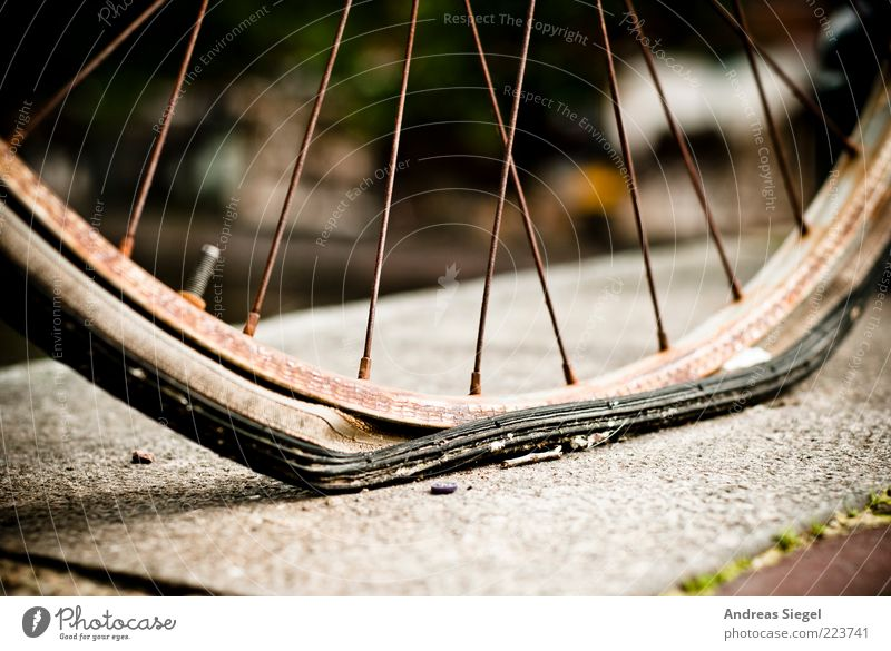 The air's out. Leisure and hobbies Loser Rubber Wheel Bicycle tyre Stone Metal Old Broken Trashy Gloomy Exhaustion Fiasco Mobility Decline Transience