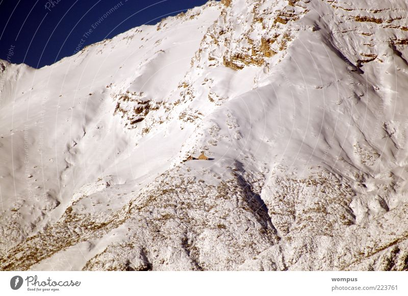 Beginning of winter in the high mountains Landscape Beautiful weather Snow Rock Alps Mountain Colour photo Exterior shot Deserted Day Long shot Slope