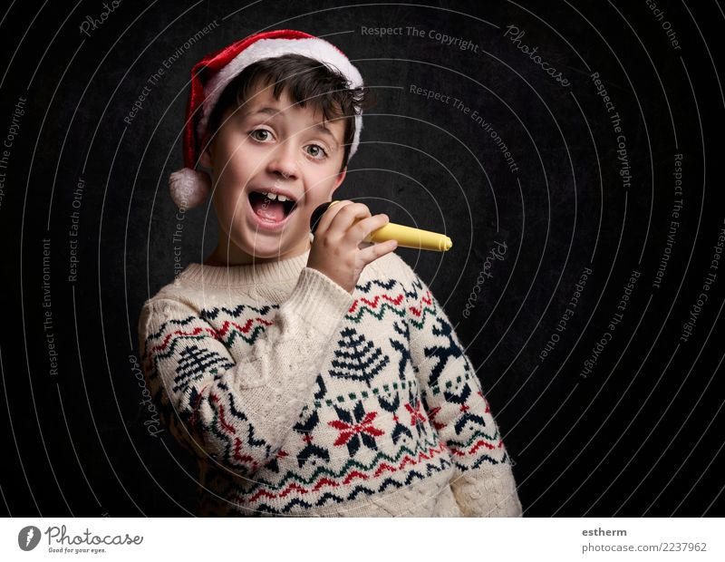 child singing Christmas carol at Christmas Child Human being Christmas & Advent Joy Lifestyle Funny Emotions Movement Feasts & Celebrations Party Masculine