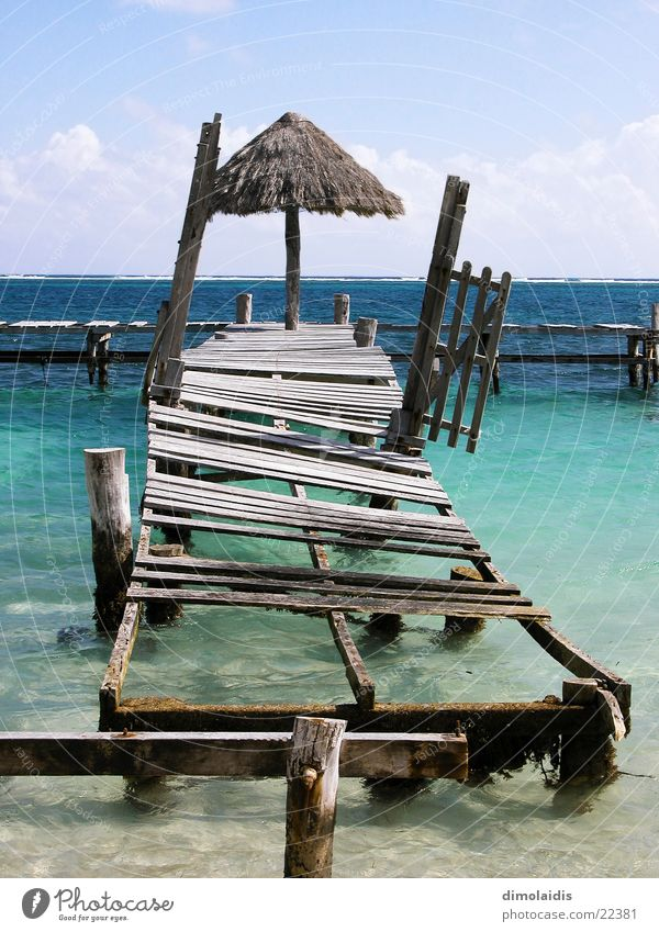 Water Sky Sun Ocean Blue Beach Vacation & Travel Clouds Wood Sand Horizon Umbrella Cuba Turquoise Footbridge Paradise