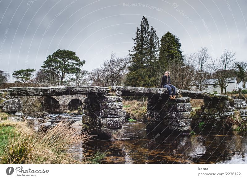 Woman sitting on a stone bridge in Dartmoor, England Lifestyle Well-being Contentment Relaxation Calm Leisure and hobbies Vacation & Travel Trip Adventure