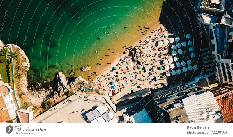 Aerial Fly Over People Crowd Having Fun On Beach In Portugal