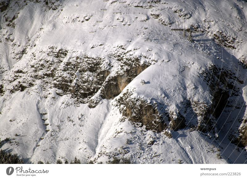 Avalanche protection buildings in extreme location Environment Nature Landscape Rock Alps Mountain Brown Gray White Colour photo Exterior shot Day