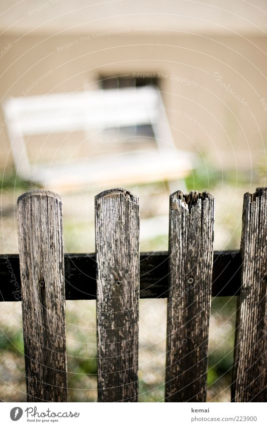 slats on the fence Living or residing Garden Terrace Village House (Residential Structure) Wall (barrier) Wall (building) Fence Fence post Wooden board