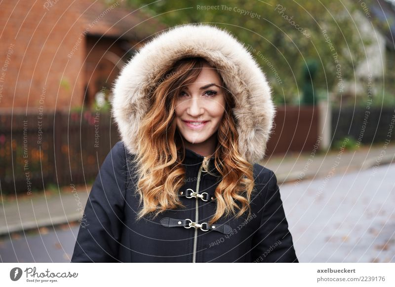 smiling young woman wearing winter coat with fake for hood Lifestyle Style Winter Human being Feminine Young woman Youth (Young adults) Woman Adults 1