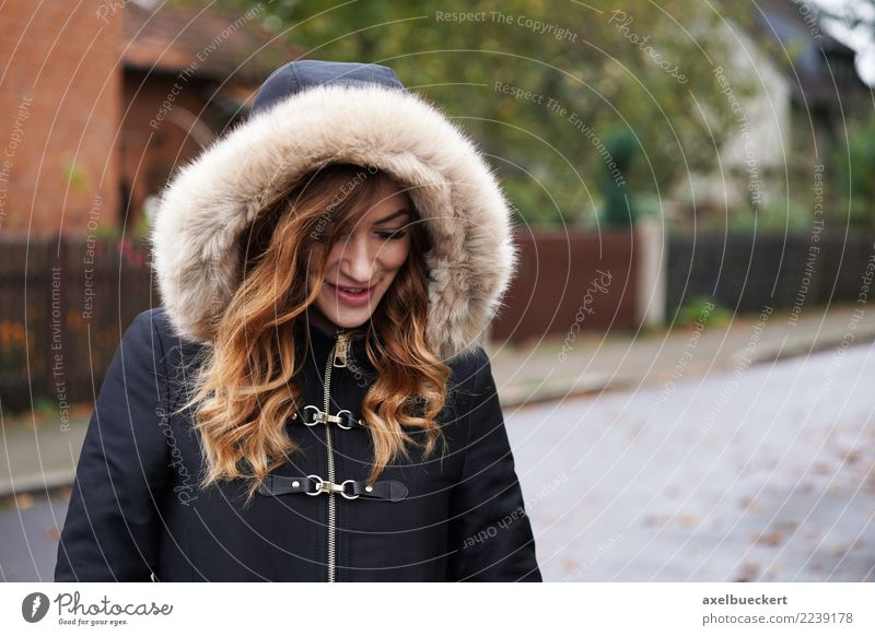 young woman wearing hooded winter coat playing coy Lifestyle Winter Human being Feminine Young woman Youth (Young adults) Woman Adults 1 18 - 30 years Village