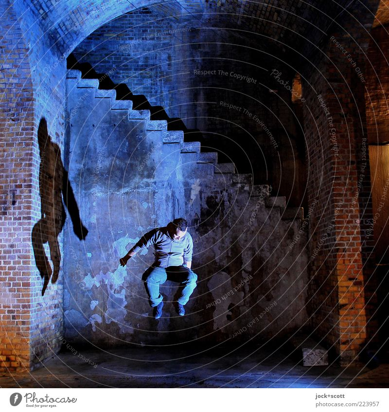 jumping rope Man Adults 1 Human being Storehouse Wall (building) Stairs Brick Movement To fall Jump Old Exceptional Fantastic Emotions Brave Experience Freedom