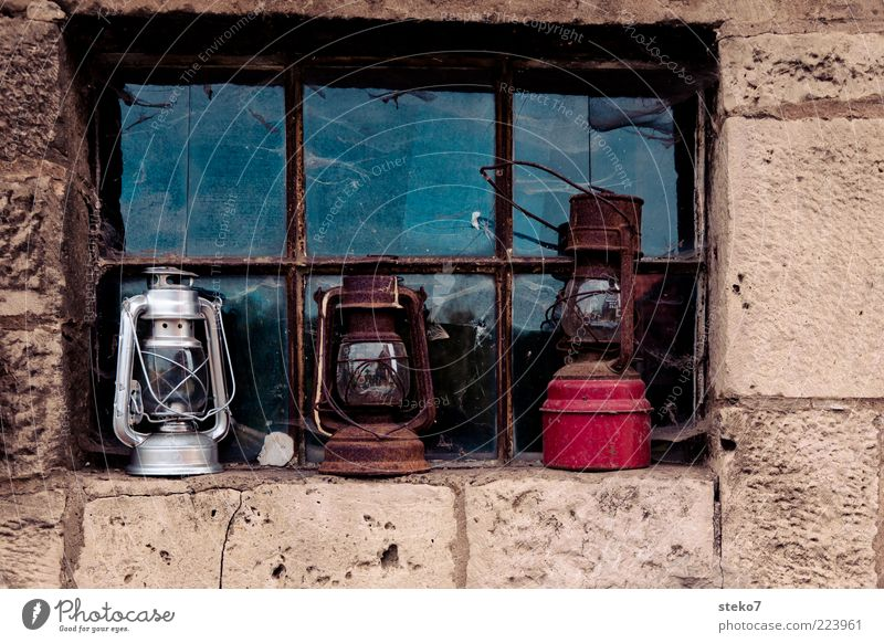3 lamps from a windowsill Wall (barrier) Wall (building) Window Old Oil lamp Red Silver Stone wall Scrap metal Multicoloured Exterior shot Deserted