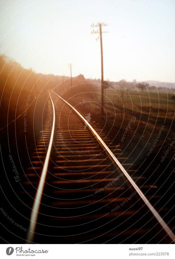 Gran tourismo Blur Railroad Railroad tracks Sunset Sunrise Ambiguous Twilight Central perspective Electricity pylon Nature Meadow Field Sunbeam