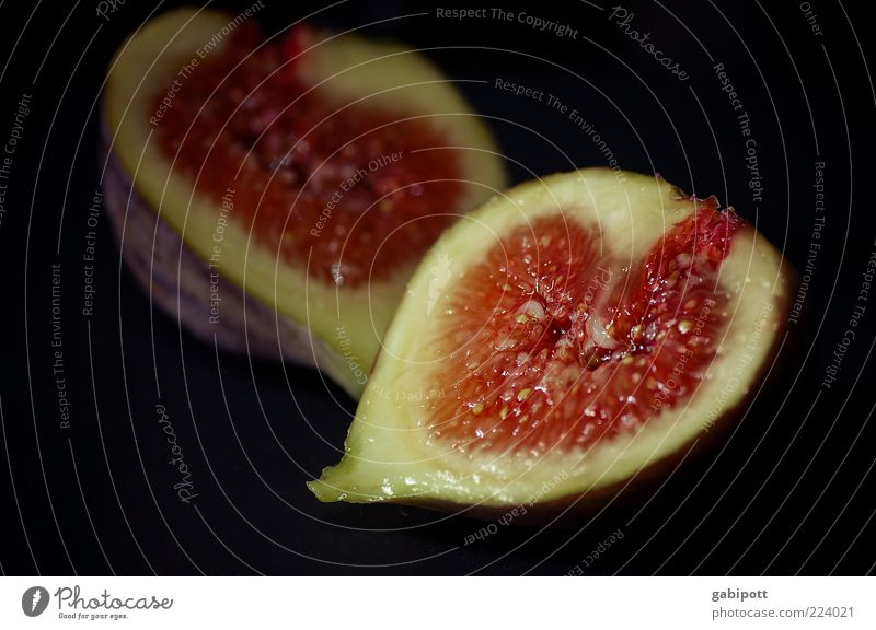 the attempt Food Fruit Fig Nutrition Exotic Delicious Juicy Red Uniqueness Pure Fruit flesh Fruity Sticky Interior shot Close-up Detail Deserted