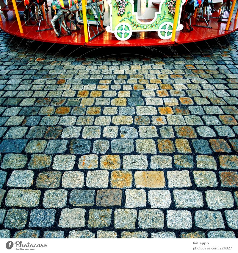 Beautiful Leisure and hobbies Fairs & Carnivals Cobblestones Paving stone Partially visible Section of image Carousel Theme-park rides Multicoloured