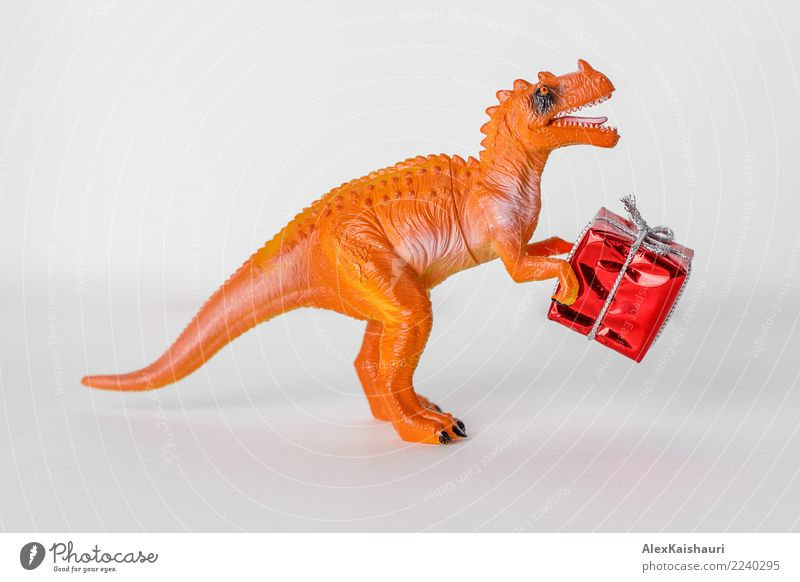 Dinosaur toy with christmas present box. Christmas & Advent White Joy Winter Funny Feasts & Celebrations Small Playing Party Happiness Creativity Gift