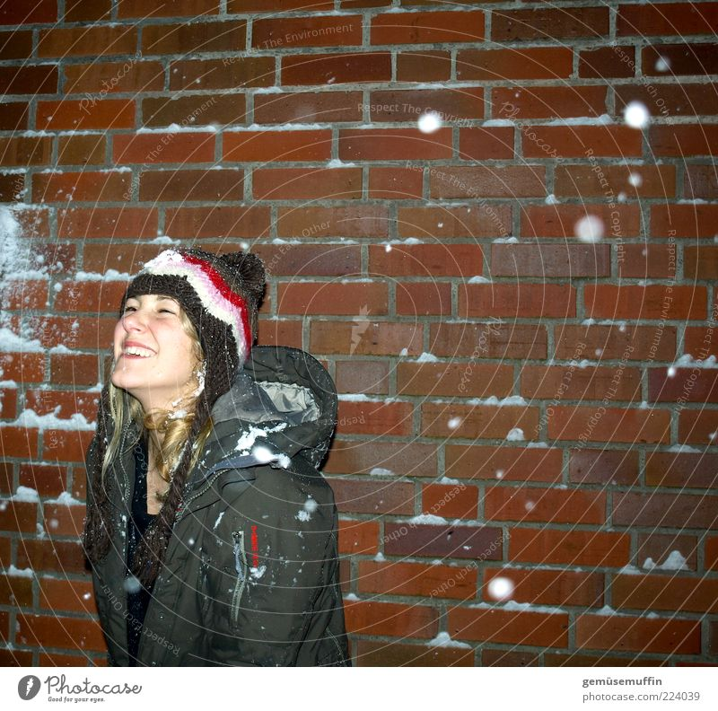 winter joy Young woman Youth (Young adults) Head 1 Human being 18 - 30 years Adults Winter Weather Ice Frost Snow Snowfall Building Facade Coat Cap Laughter