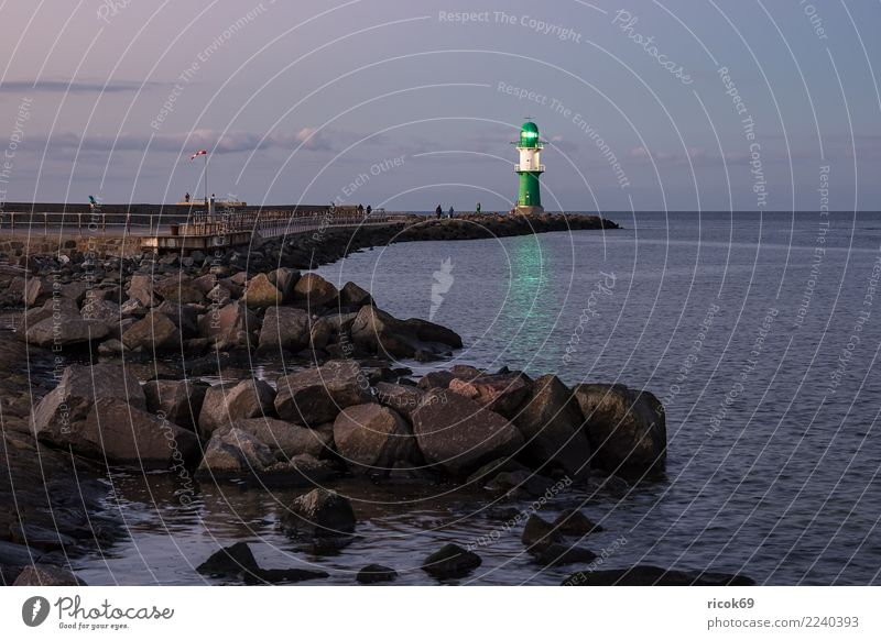 Mole at the Baltic Sea coast in Warnemünde Relaxation Vacation & Travel Tourism Ocean Nature Landscape Water Clouds Rock Coast Lighthouse Architecture