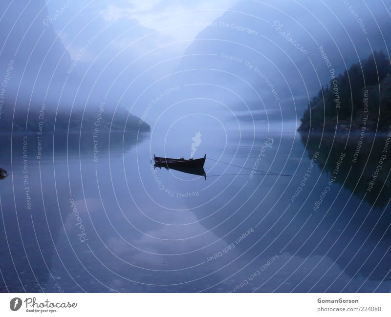 Boat by the fjord Water Autumn Fog Lakeside Fjord Fishing boat Watercraft Blue Calm Loneliness Relaxation Vacation & Travel Colour photo Exterior shot Deserted