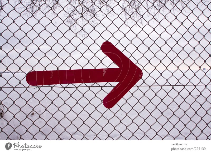 Right Sign Signs and labeling Arrow Orderliness Direction Orientation Fence Wire netting Border Boundary Boundary line Colour photo Exterior shot Day Deserted