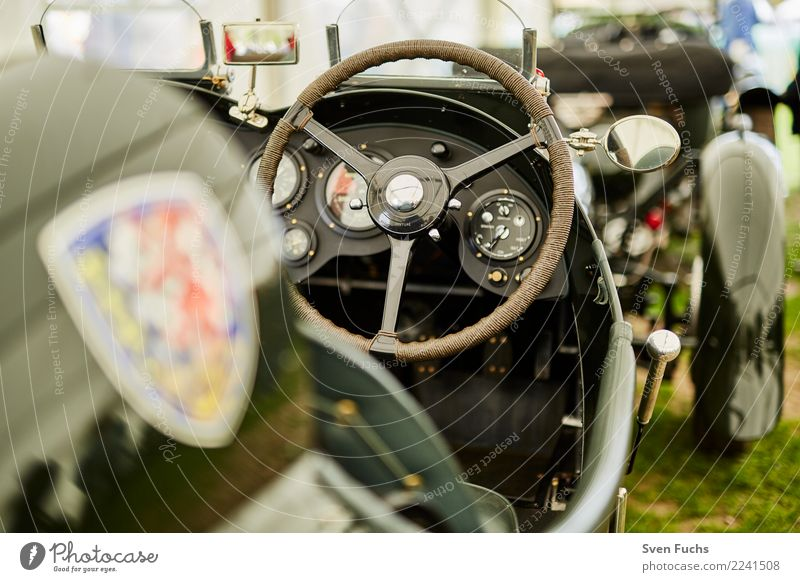 Cockpit of a classic car racing car Shows Means of transport Passenger traffic Motoring Vehicle Car Vintage car Convertible Sports car Green Nostalgia Insurance