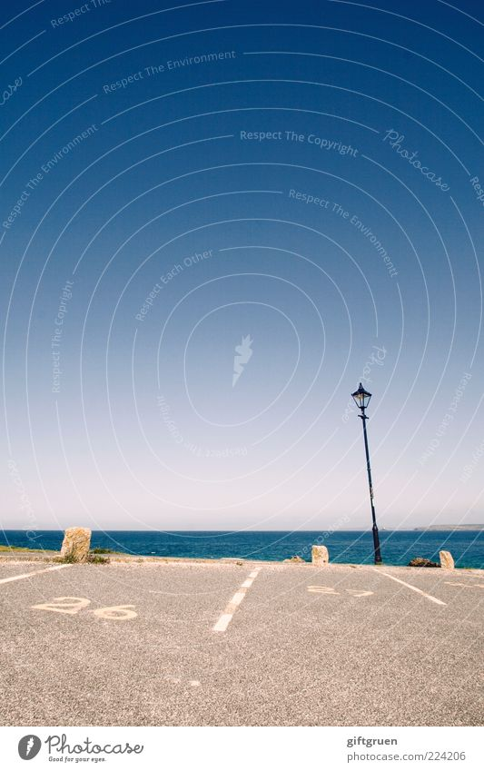 near the water Environment Water Sky Cloudless sky Coast Ocean Lantern Lighting Parking lot Parking space number Horizon 26 Digits and numbers Characters