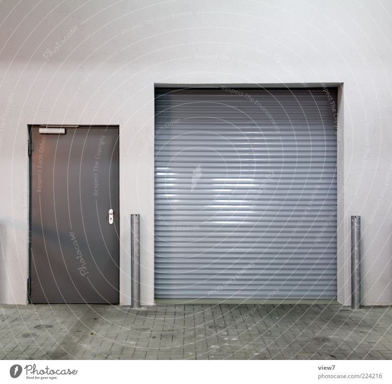 grey in grey in mouse grey Logistics Manmade structures Wall (barrier) Wall (building) Facade Door Metal Esthetic Authentic Simple Modern Original Gray Design